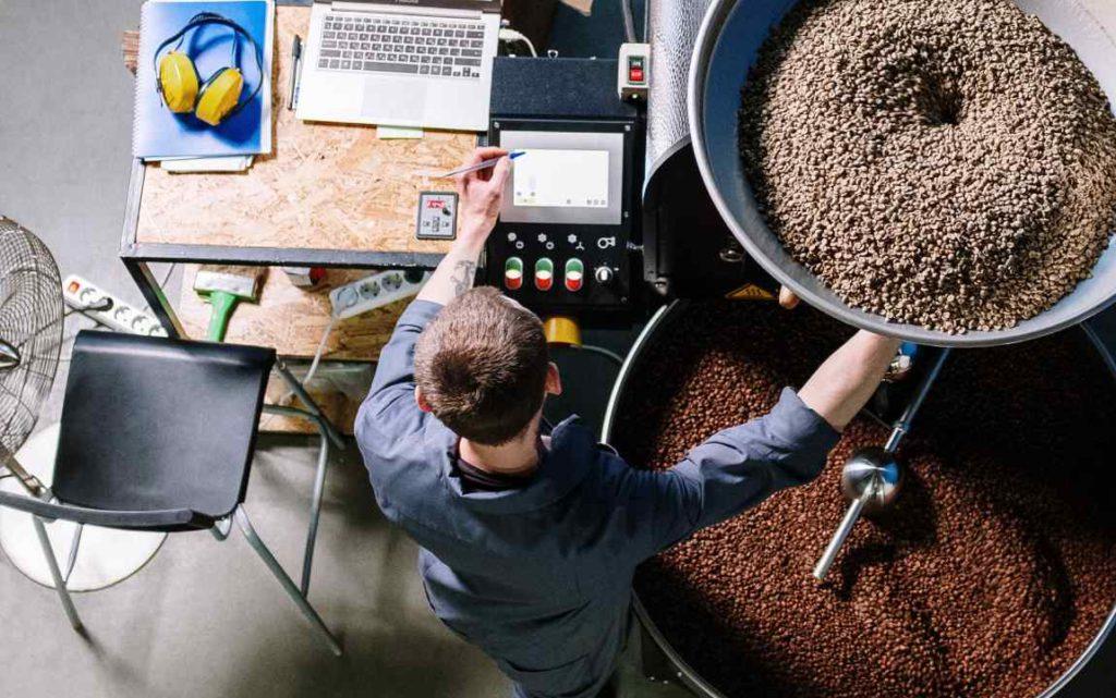man roasting coffee