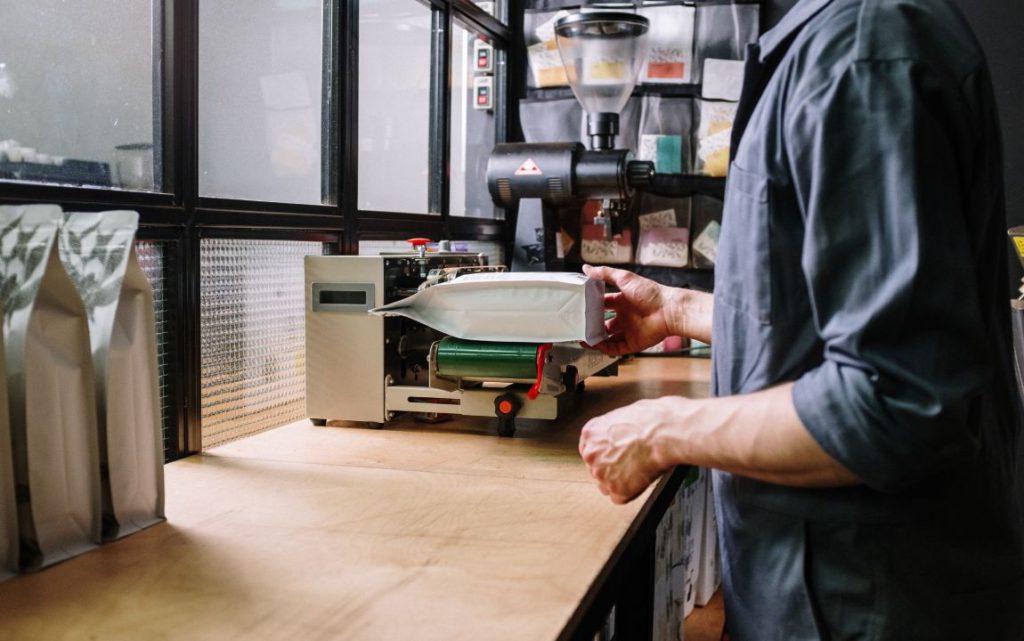 sealing coffee packaging in a roastery