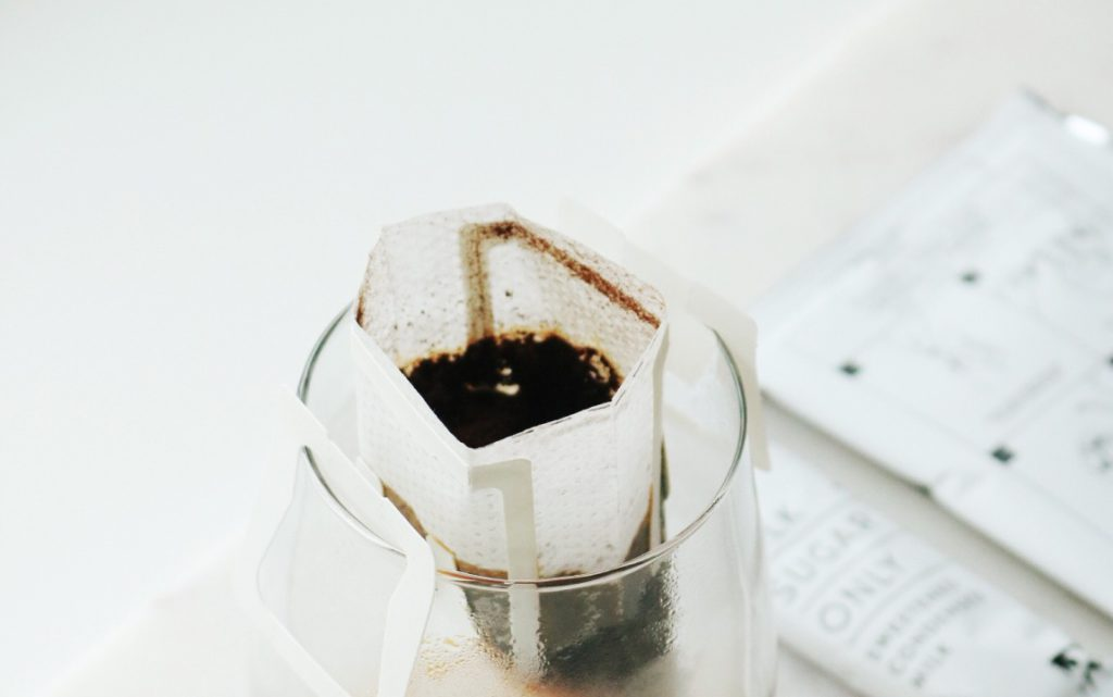 coffee pouch over glass