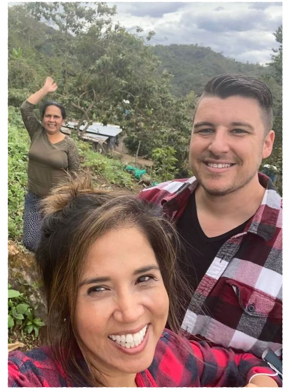clint and haydee from khomanta coffee with a peruvian coffee producer